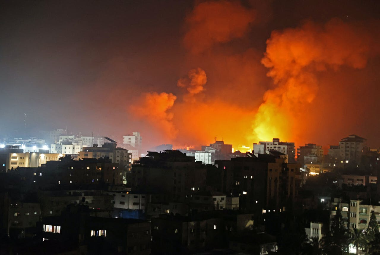 Fire erupts from the Andalus Tower as it is destroyed by an Israeli airstrike in Gaza City, controlled by the Palestinian Hamas movement, early on May 16, 2021. Israel pummelled the Gaza Strip with air strikes, killing 10 members of an extended family and demolishing a building housing international media outlets, as Palestinian militants fired back barrages of rockets. MOHAMMED ABED / AFP