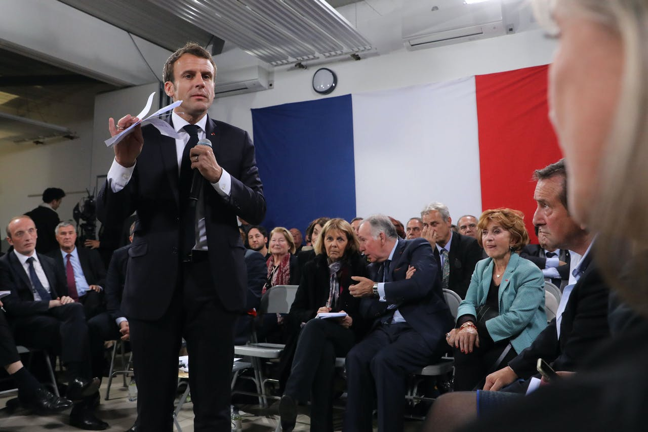 "2019-04-04 20:28:04 French president Emmanuel Macron (L) speaks during the last public meeting set as part of his ""Great National Debate"" in Cozzano, on the French mediterranean island of Corsica, on April 4, 2019. French President Emmanuel Macron on April 4, 2019 wound up almost four months of town hall meetings aimed at reviving a presidency battered by weeks of street unrest with a prickly visit to France's Mediterranean island of Corsica. Ludovic MARIN / AFP"