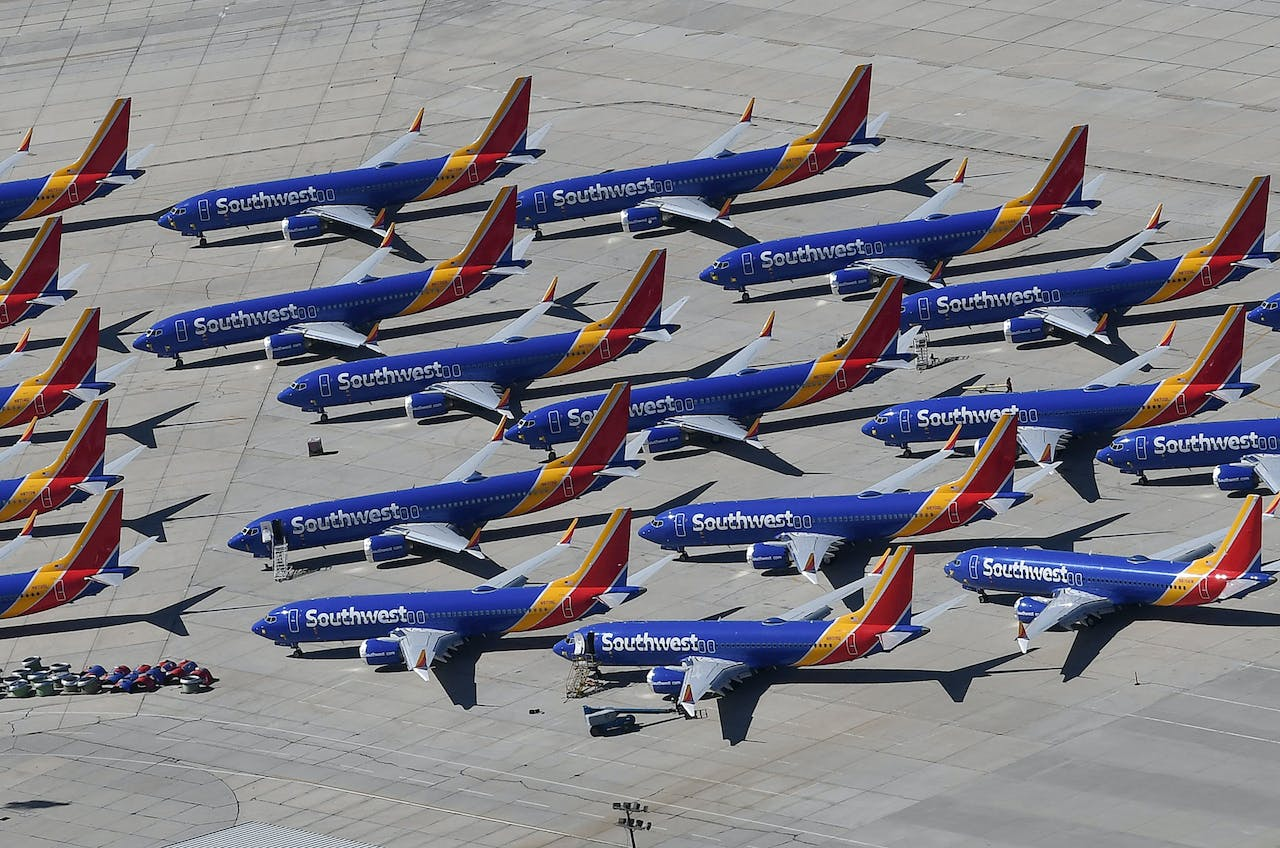2019-03-28 15:12:57 Southwest Airlines Boeing 737 MAX aircraft are parked on the tarmac after being grounded, at the Southern California Logistics Airport in Victorville, California on March 28, 2019. After two fatal crashes in five months, Boeing is trying hard -- very hard -- to present itself as unfazed by the crisis that surrounds the company. The company's sprawling factory in Renton, Washington is a hive of activity on this sunny Wednesday, March 28, 2019, during a tightly-managed media tour as Boeing tries to communicate confidence that it has nothing to hide. Boeing gathered hundreds of pilots and reporters to unveil the changes to the MCAS stall prevention system, which has been implicated in the crashes in Ethiopia and Indonesia, as part of a charm offensive to restore the company's reputation. Mark RALSTON / AFP