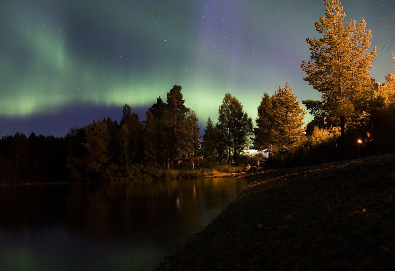 Het Noorderlicht verschijnt aan de hemel van het Zweedse dorp Erikslund. JONATHAN NACKSTRAND