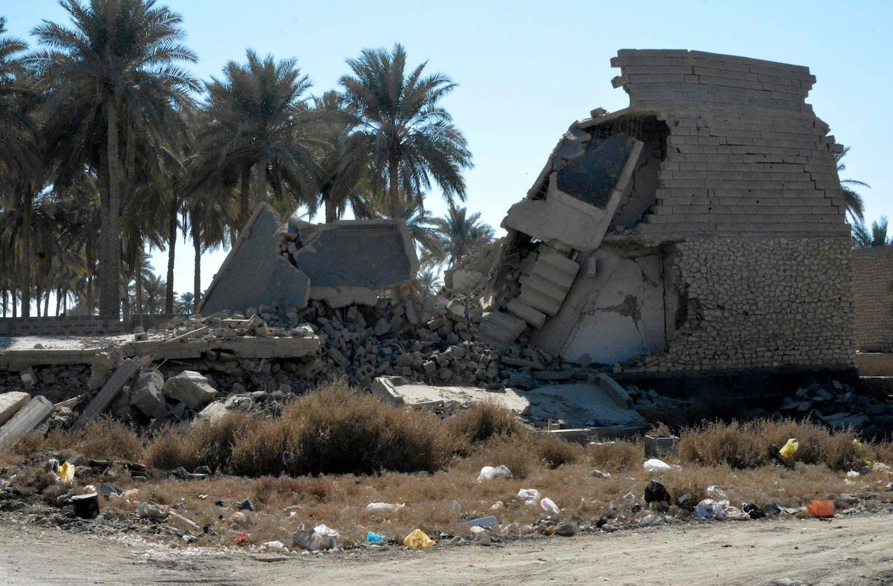 Een kapotgeschoten huis in de Irakese stad Ramadi