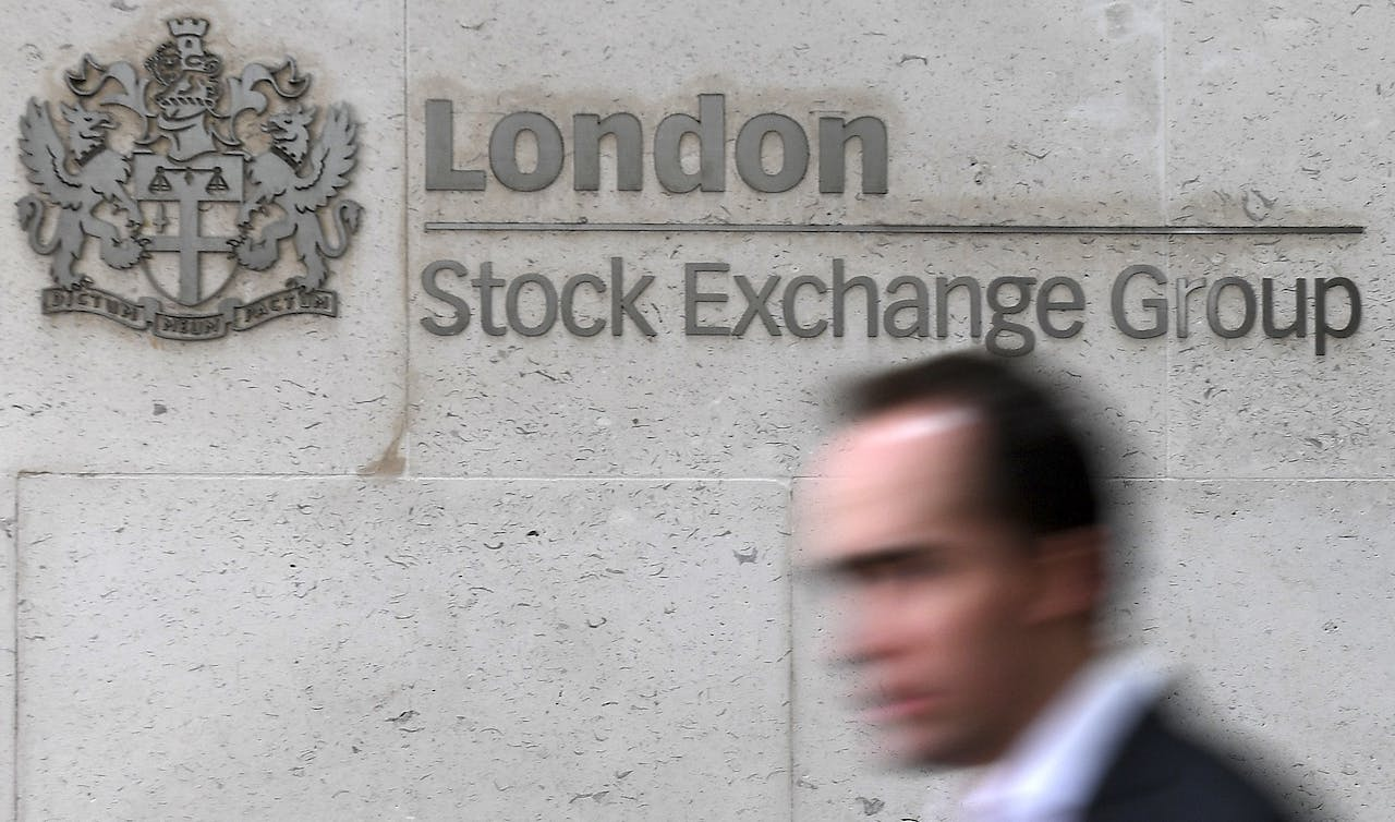 2017-02-27 12:16:38 epa05876645 (FILE) - A man passes the signage of the London Stock Exchange Group (LSE) in London, Britain, 27 February 2017. The planned fusion of Deutsche Boerse and London Stock Exchange (LSE) has been blocked by the EU regulators, media reports state on 29 March 2017. EPA/ANDY RAIN