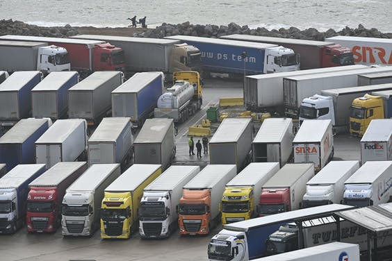 2020-12-22 11:27:23 Freight lorries are seen parked at Dover Marina in Kent, south east England on December 22, 2020, adjacent to the Port of Dover as queuing trucks wait to continue their journeys after France closed its borders to accompanied freight arriving from the UK due to the rapid spread of a new coronavirus strain. Britain sought to sound a note of calm saying they were working as fast as possible to unblock trade across the Channel after France shut its borders to UK hauliers in a bid to contain a new variant of the coronavirus. JUSTIN TALLIS / AFP