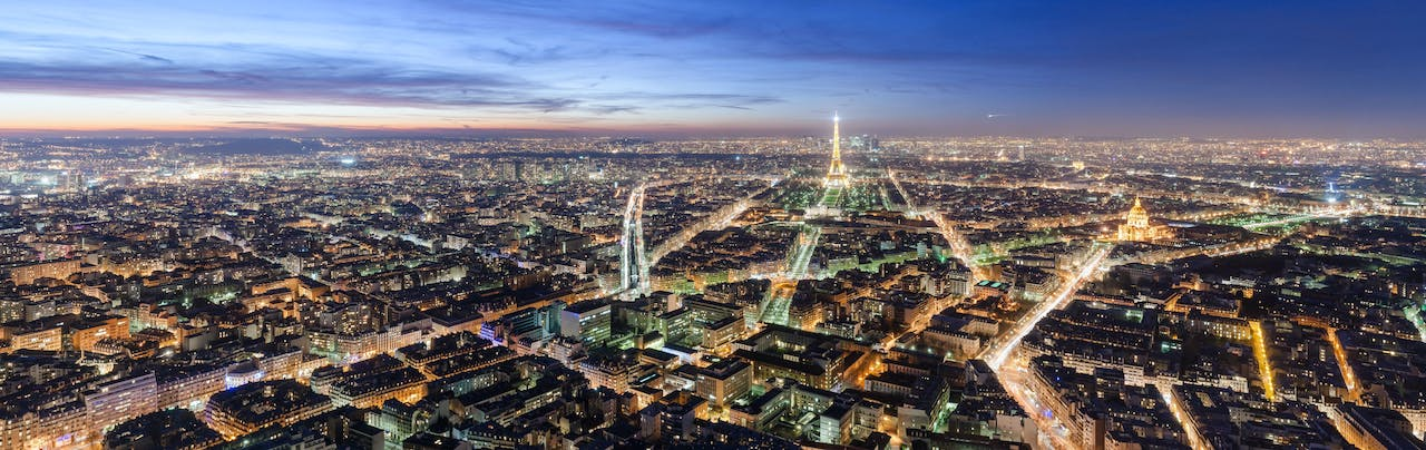 View over Paris at dusk, from the top platform of the Montparnasse tower, in 2008