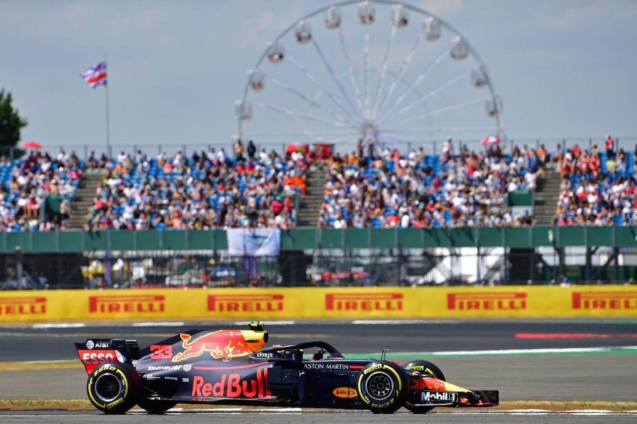 Red Bull's Dutch driver Max Verstappen drives during the qualifying session at Silverstone motor racing circuit in Silverstone, central England, on July 7, 2018 ahead of the British Formula One Grand Prix. / AFP PHOTO / Andrej ISAKOVIC