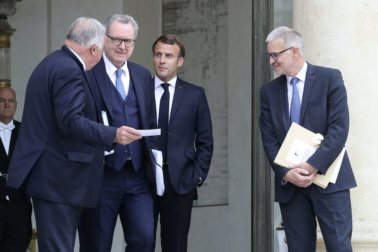 """2020-07-02 19:05:08 French President Emmanuel Macron (2ndR) accompanies President of the French Senate Gerard Larcher (L), President of the French National Assembly Richard Ferrand (2ndL) and Economic, Social and Environmental Council (CESE) President Patrick Bernasconi after handovering him their report on the """"Essential Priorities for the Revival of France 2020"""" at the Elysee Palace in Paris on July 2, 2020. Ludovic Marin / AFP"""