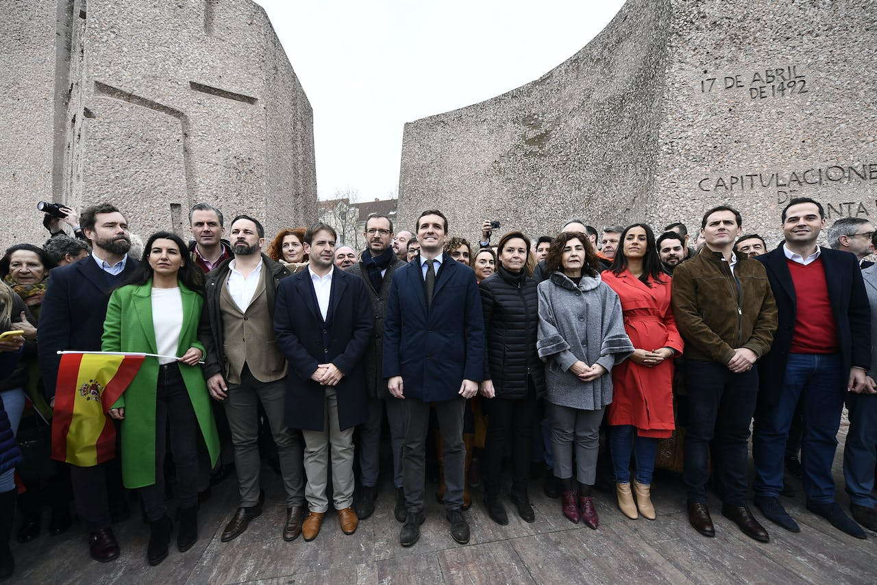 2019-02-10 14:11:15 Spanish People's Party (PP) president Pablo Casado (C) and Spanish far-right Vox party leader Santiago Abascal (front 3rdL) attend a demonstration in Madrid against Spanish Prime Minister Pedro Sanchez on February 10, 2019. The conservative Popular Party (PP), centre-right Ciudadanos and far-right Vox have all called on their supporters to take to the streets of Madrid against Sanchez after accusing him of making concessions to Catalan separatists. OSCAR DEL POZO / AFP