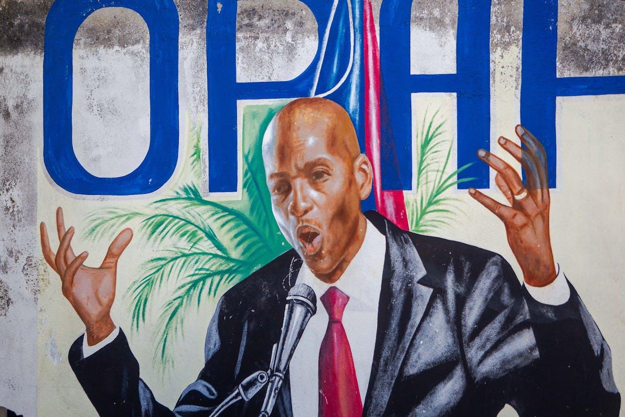 Muurschildering van de vermoorde resident Jovenel Moise in Port-au-Prince, Haiti