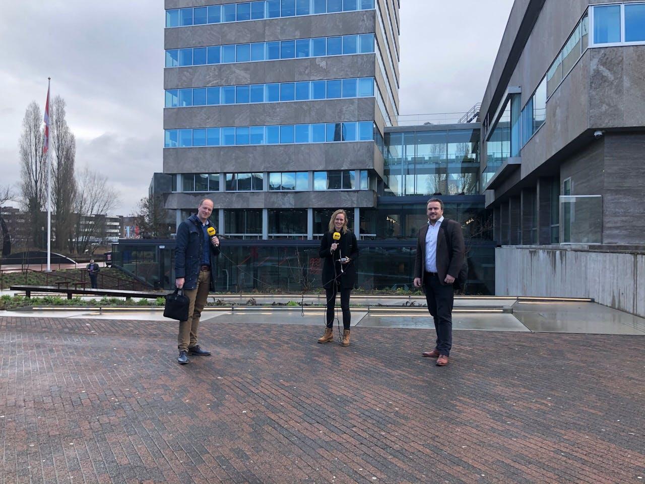Op de achtergrond de gerenoveerde stadhuistoren in Eindhoven.
