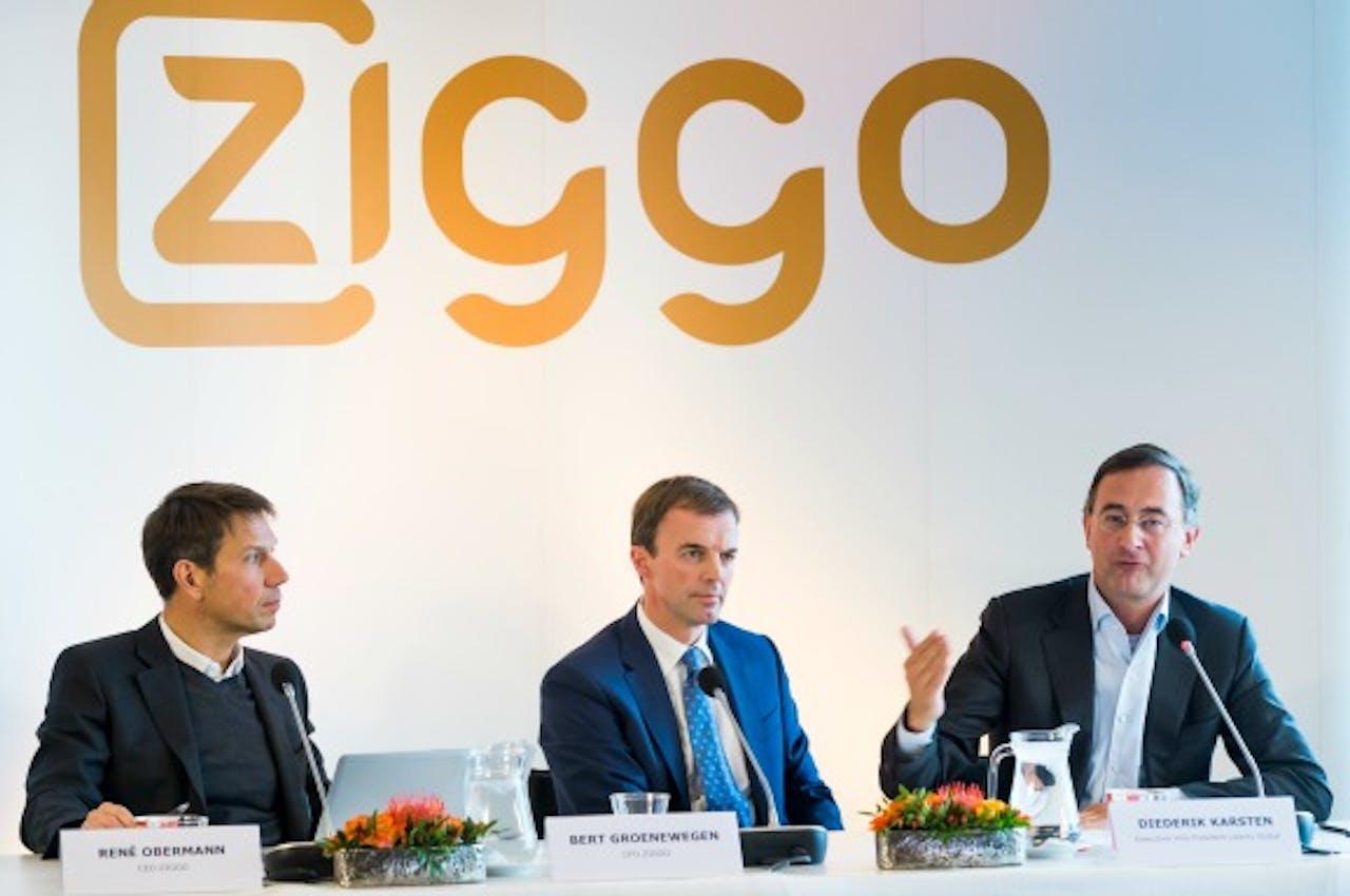 (VLNR) Rene Obermann, CEO van kabelexploitant Ziggo, Bert Groenewegen, financieel bestuurder van Ziggo en Diederik Karsten, executive Vice President of Liberty Global's European Broadband Operations tijdens een persconferencie. Foto: ANP