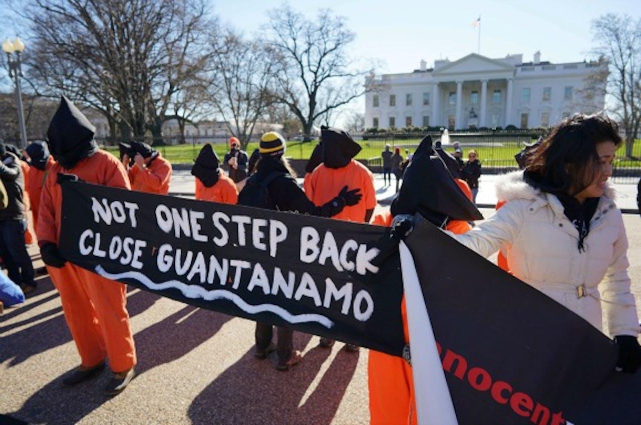 Demonstranten voor het Witte Huis protesteren tegen gevangenis Guantánamo Bay in Cuba. Foto ANP