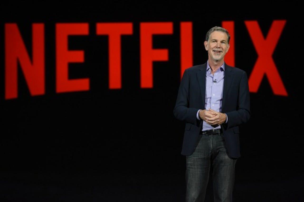 Netflix-topman Reed Hastings tijdens een presentatie in januari 2016. Foto: ANP/AFP