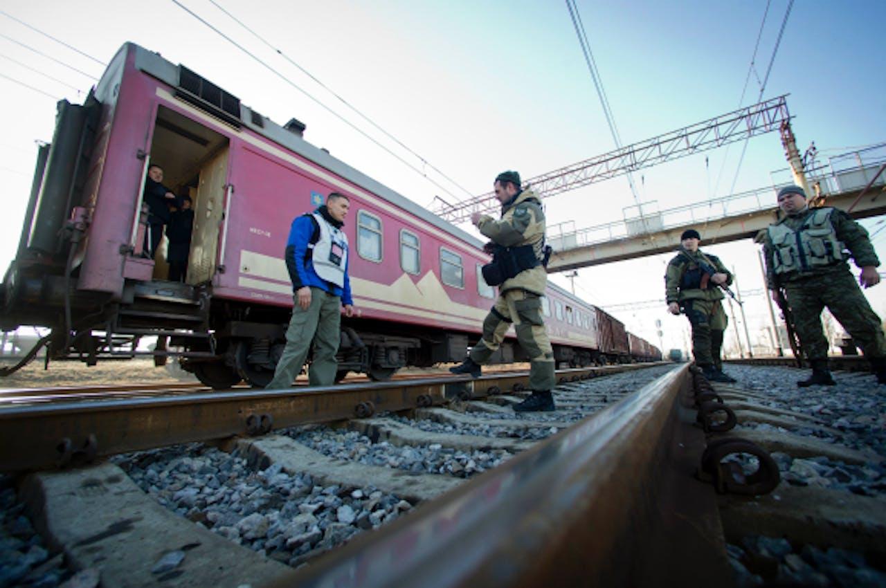 Foto: ANP - Trein met de geborgen wrakstukken (2014)