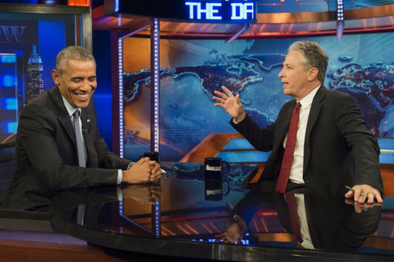 Foto: ANP/AFP - Obama en Stewart