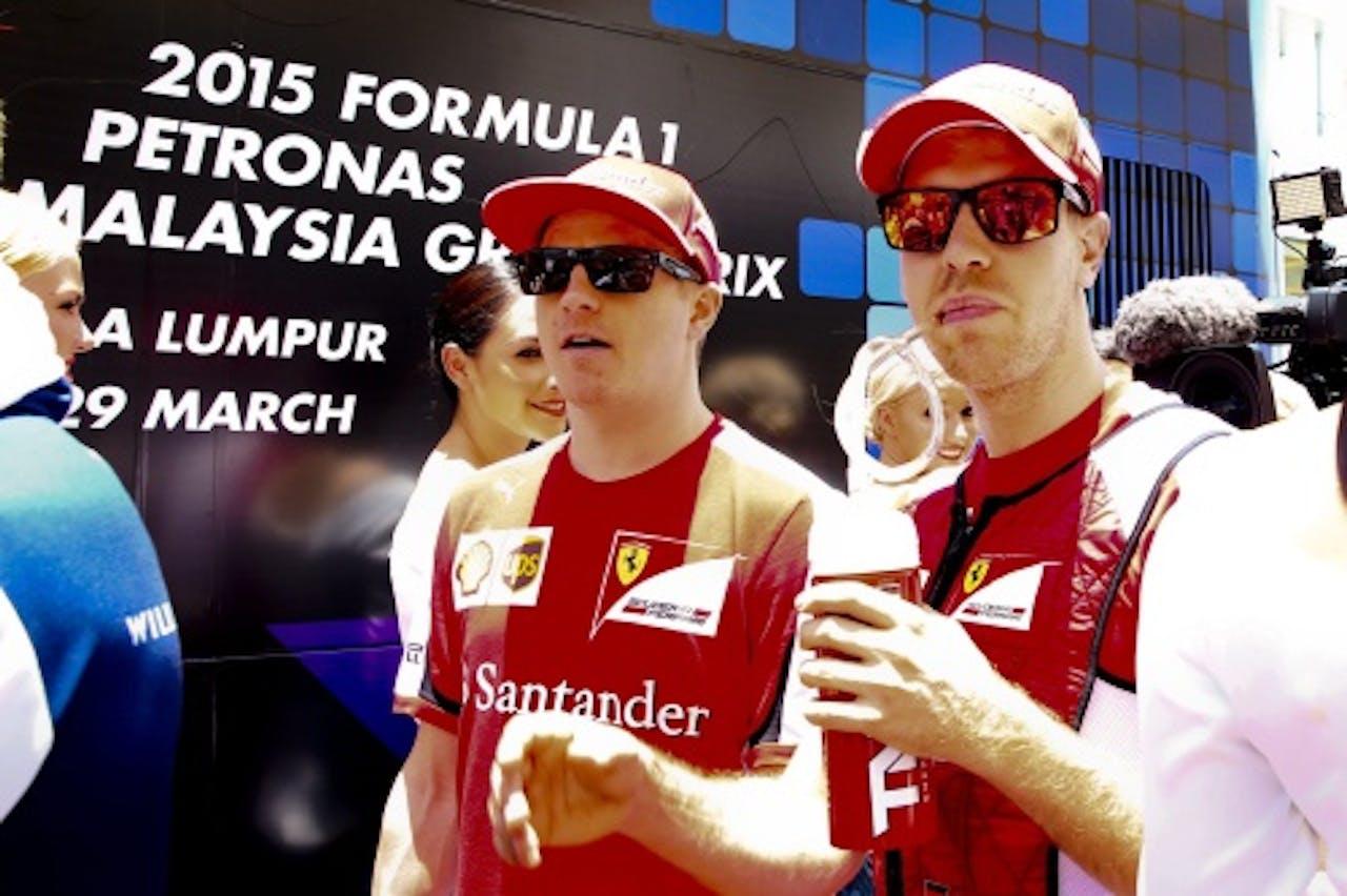 Räikkönen (L) en Vettel. EPA