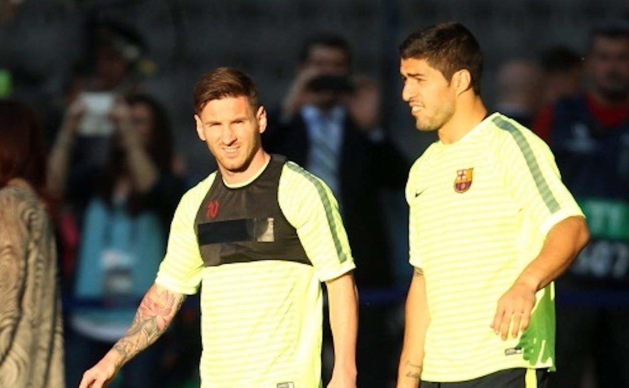 Messi (L) en Suarez. EPA