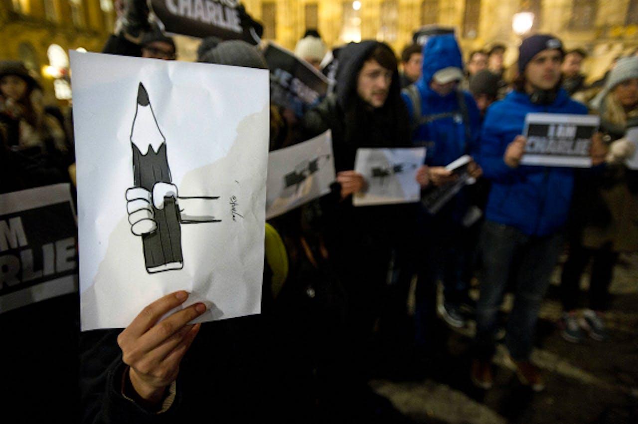 Foto: ANP - Deelnemers aan een demonstratie op de Dam voor de persvrijheid