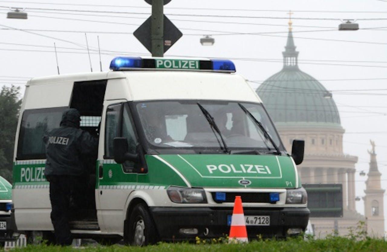 Archiefbeeld van een Duits politiebusje. EPA
