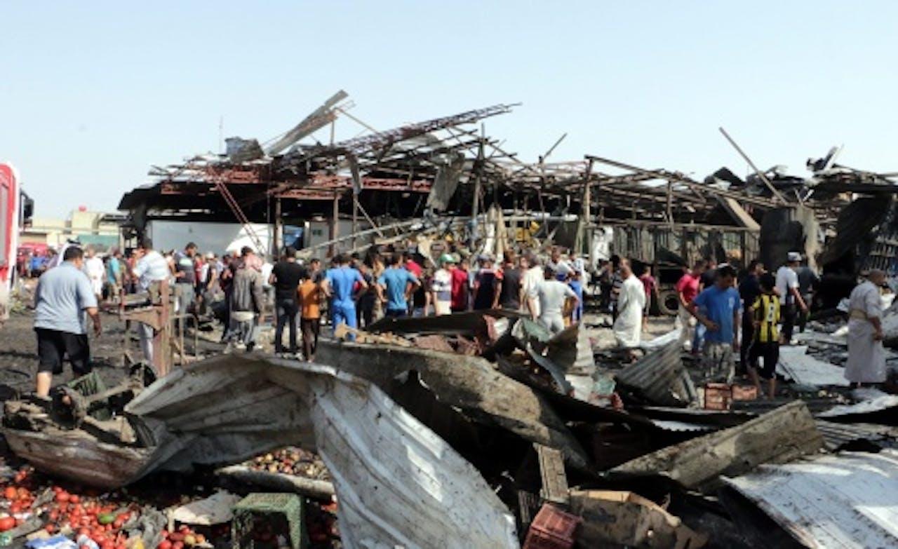 Puinhopen na een door IS geclaimde aanval in Irak. EPA