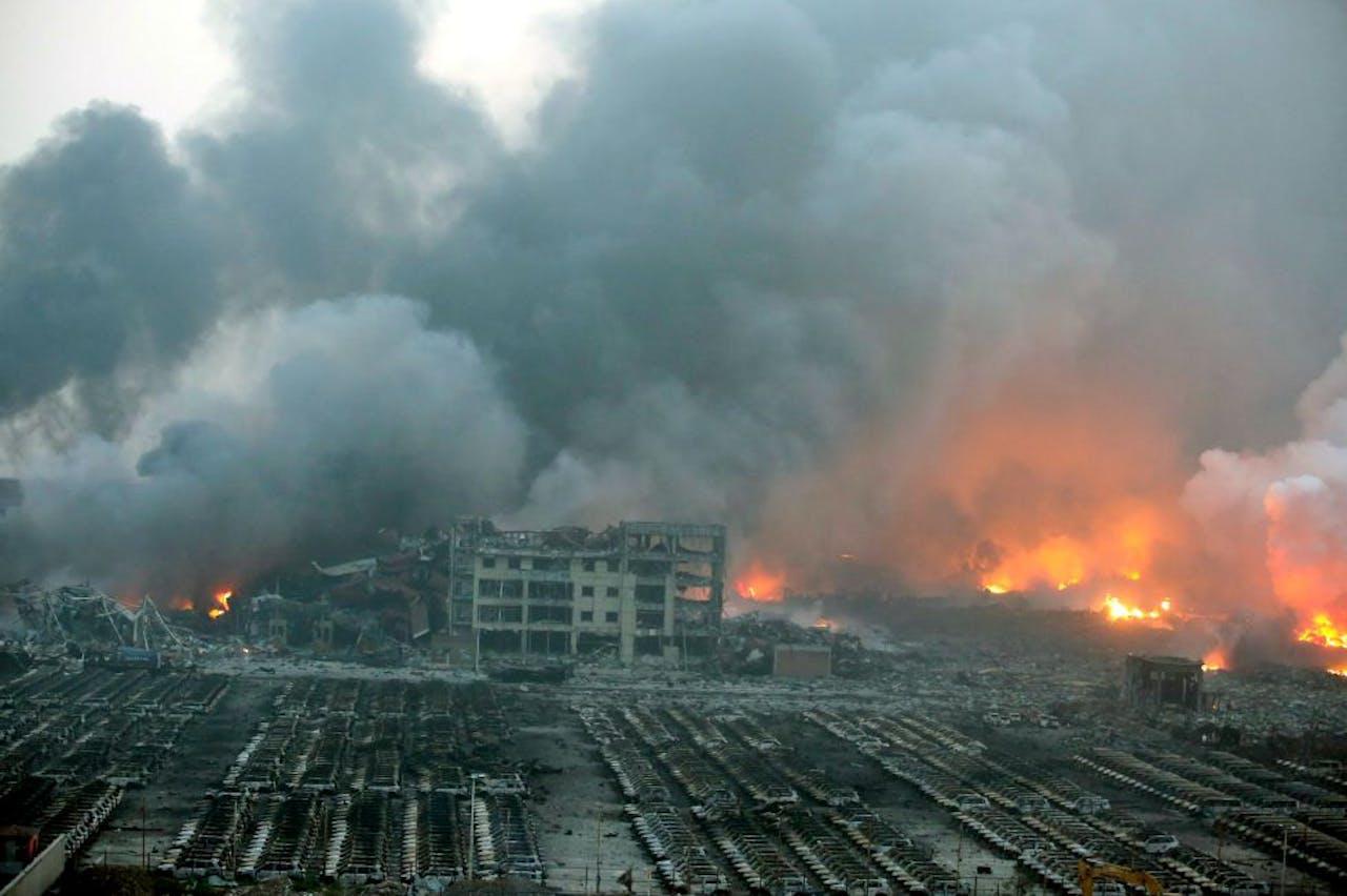 De verwoesting na de ontploffingen bij een terminal waar chemische stoffen opgeslagen werden in de Chinese havenstad Tianjin. Foto ANP