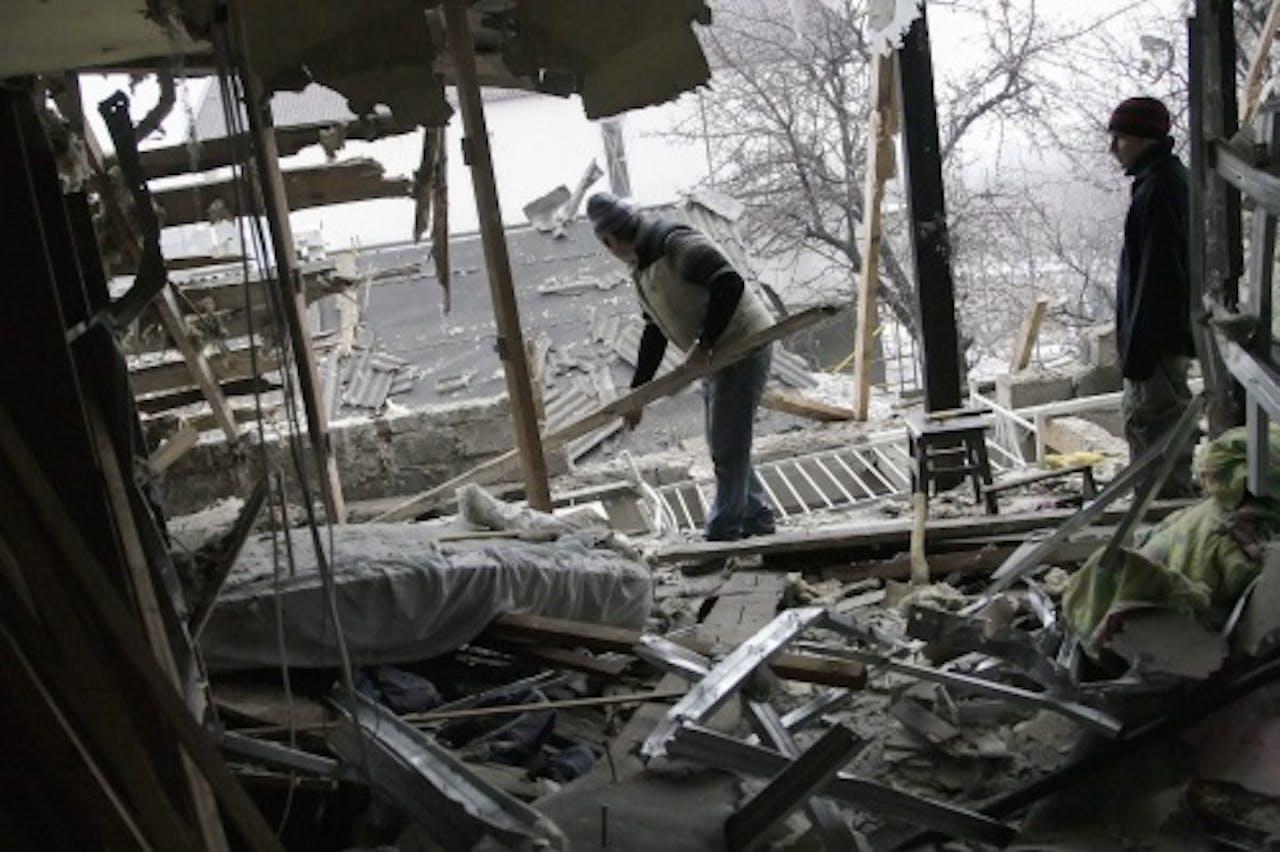 Restanten van huizen in Donetsk. EPA