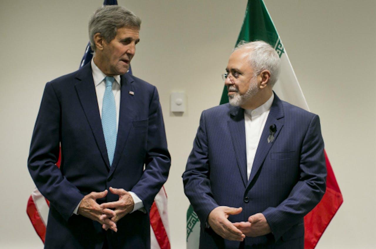 De Amerikaanse minister van Buitenlandse Zaken John Kerry en zijn Iraanse collega Javad Zarif. Foto: ANP