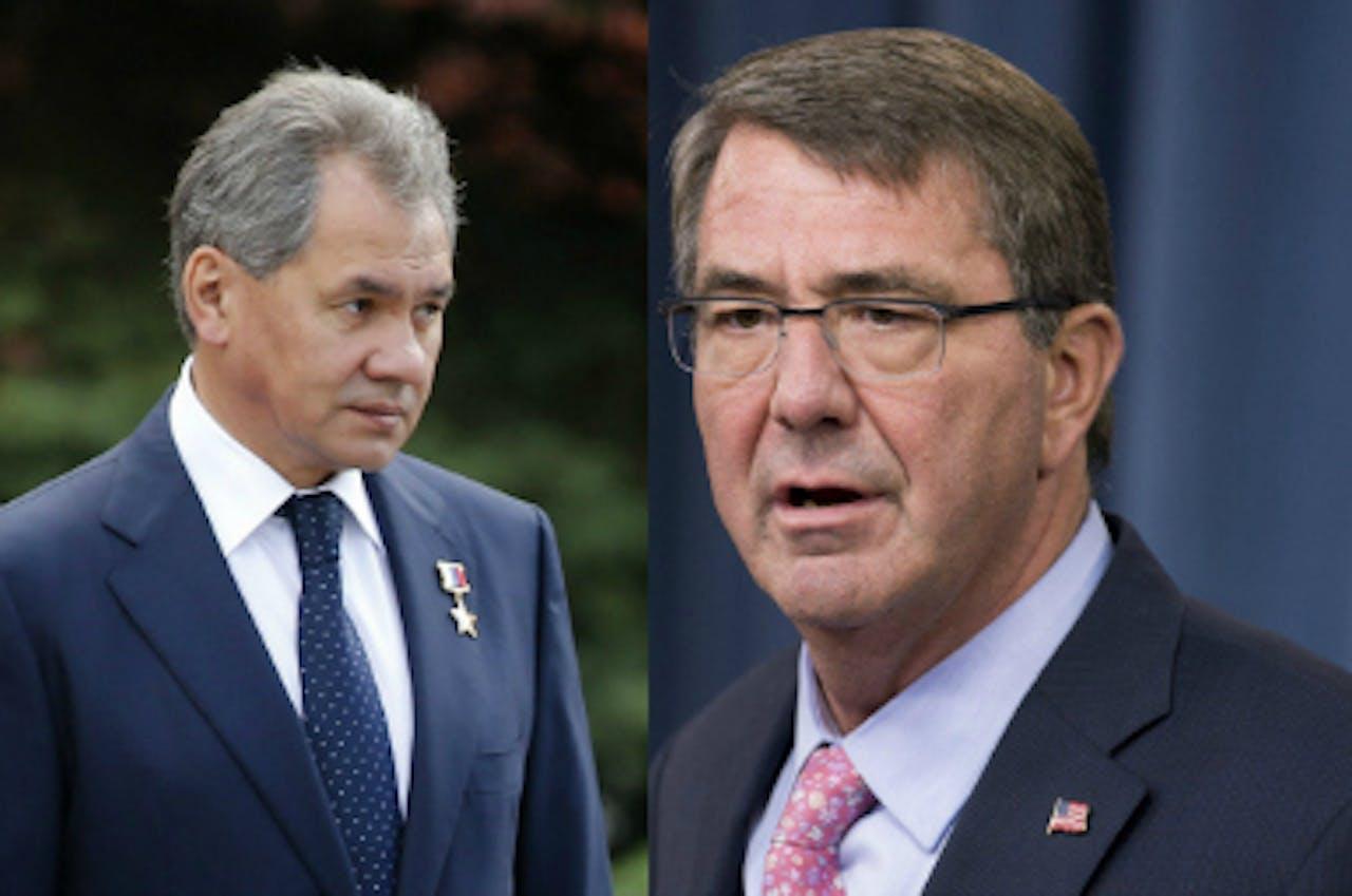 Links de Russische minister van Defensie Sergej Sjojgoe, en rechts zijn Amerikaanse collega Chuck Hagel. Foto: ANP