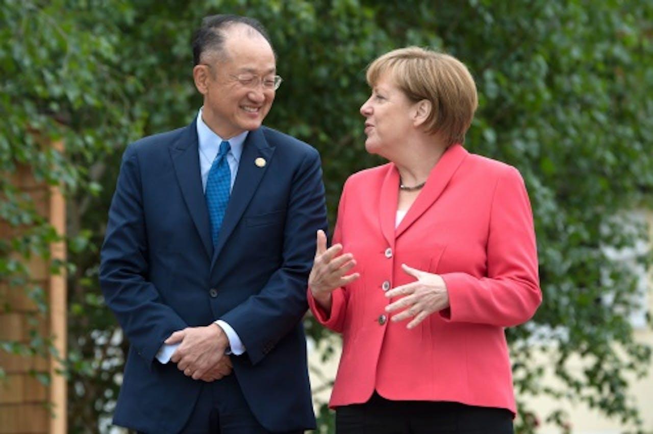 Jim Kim en Angela Merkel. EPA