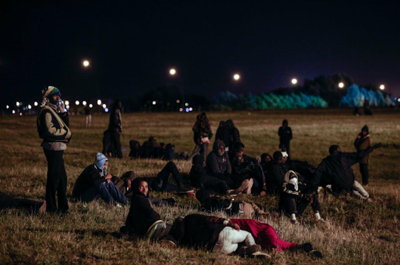 Foto: ANP/EPA - Vluchtelingen in Calais