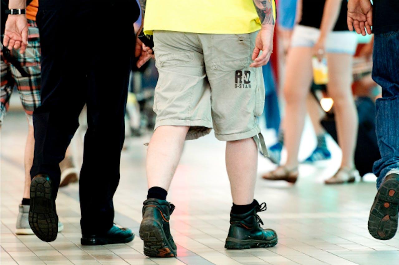 Foto: ANP - Korte broek op kantoor? Not done, zeggen etiquette-experts.