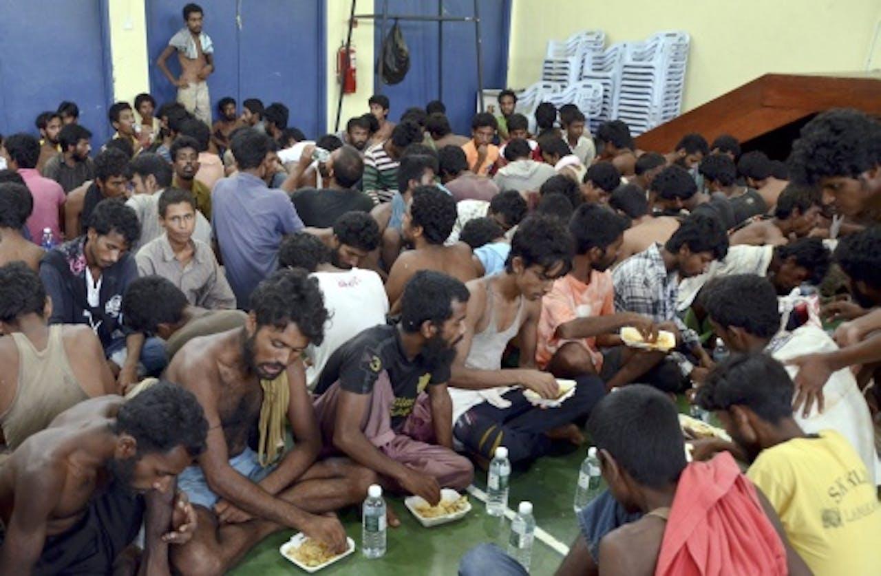 Vluchtelingen op een politiebureau in Maleisië. EPA