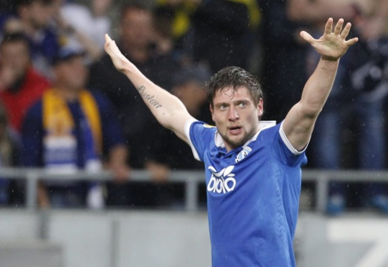 Yevhen Seleznyov van Dnjepr juicht na scoren tegen Napoli. EPA