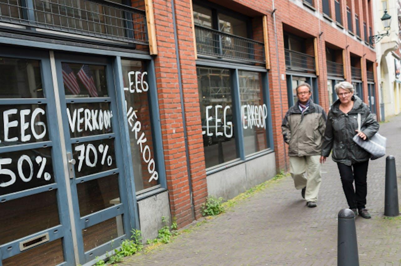 Foto: ANP - Een leegstaand winkelpand in Den Haag