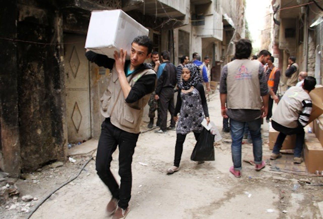 Medewerkers van de VN aan het werk in Syrië. EPA