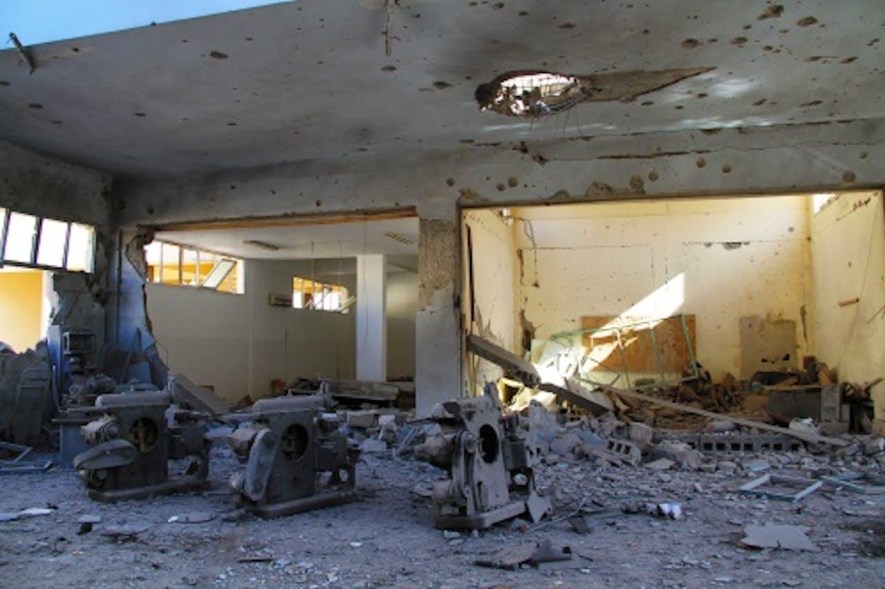 Archieffoto, verwoest gebouw in Benghazi EPA