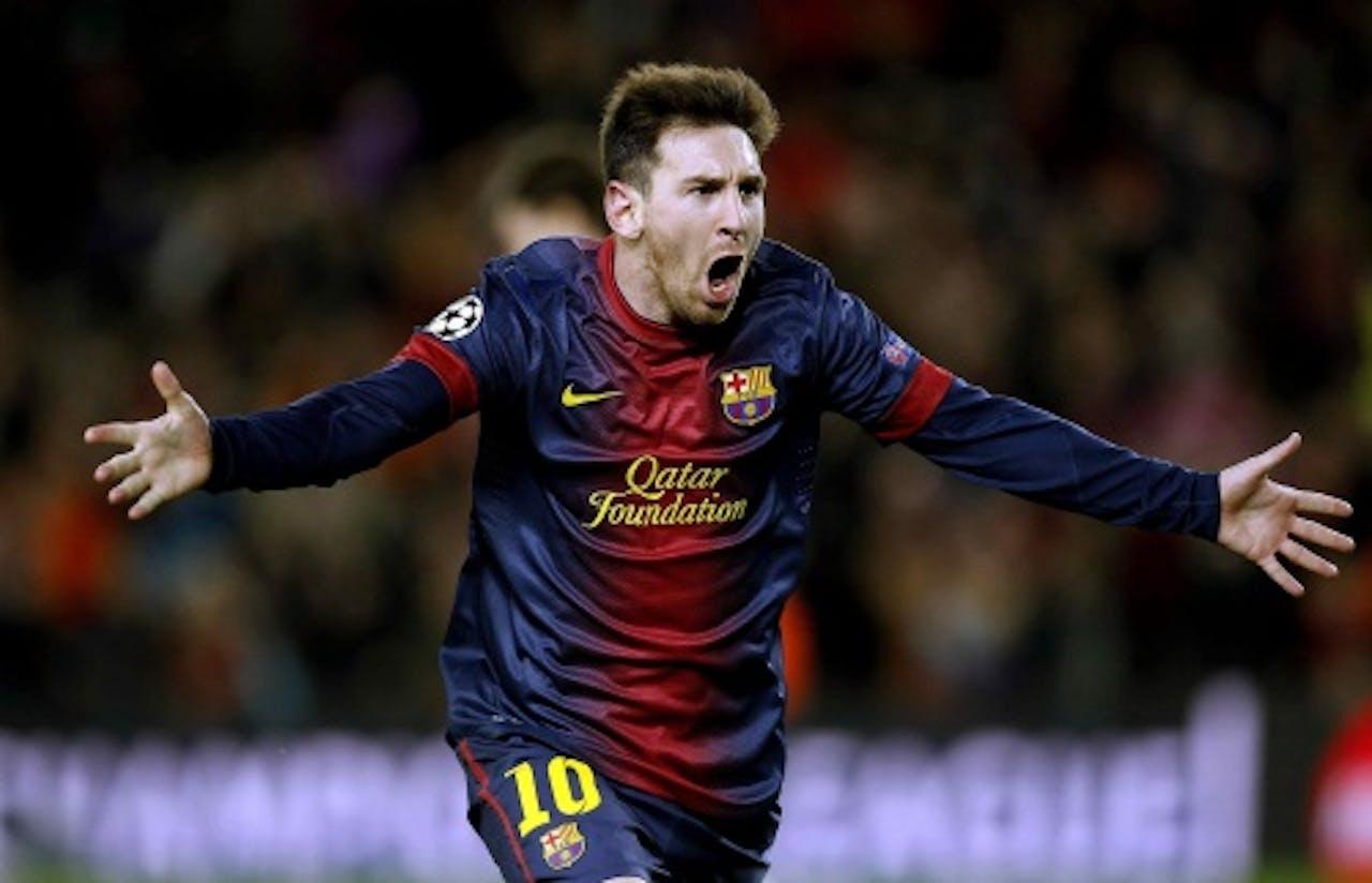 Lionel Messi van FC Barcelona viert zijn tweede goal tegen AC Milan. EPA