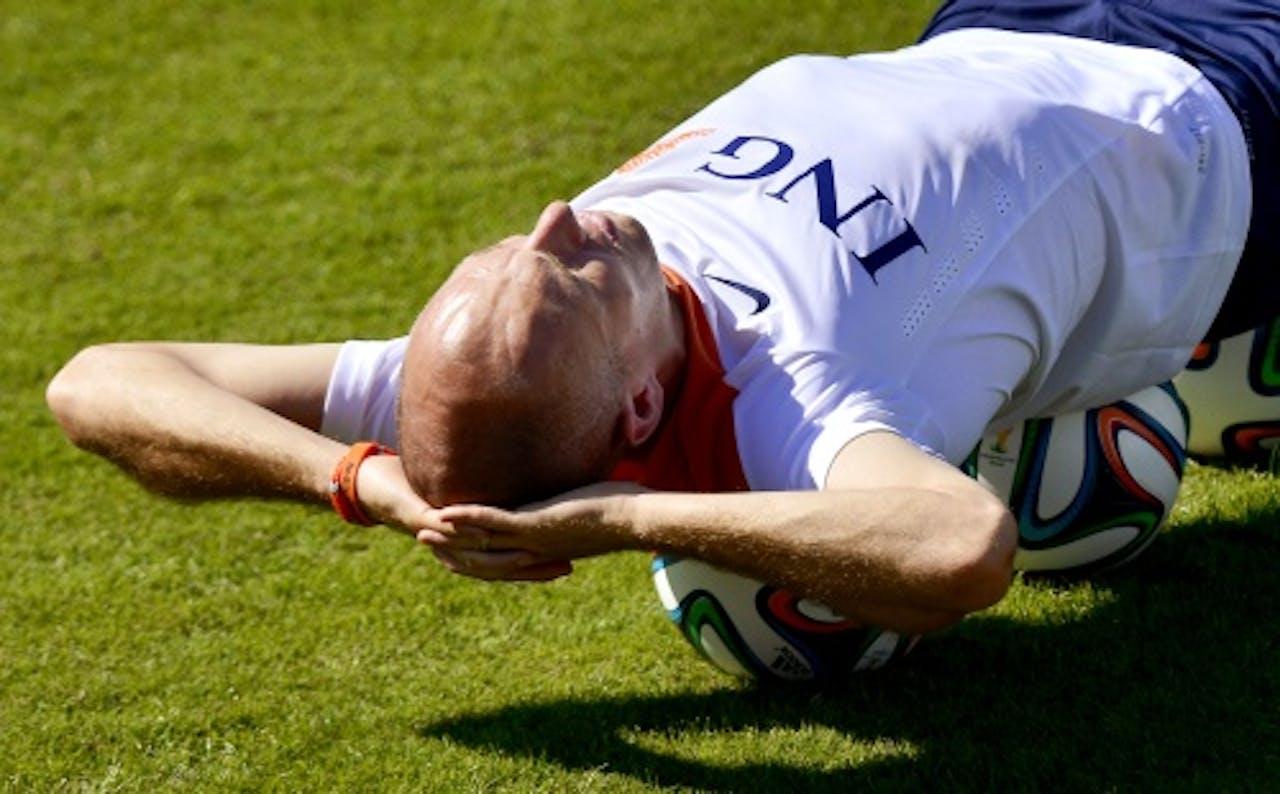 Robben met bandje op training. ANP