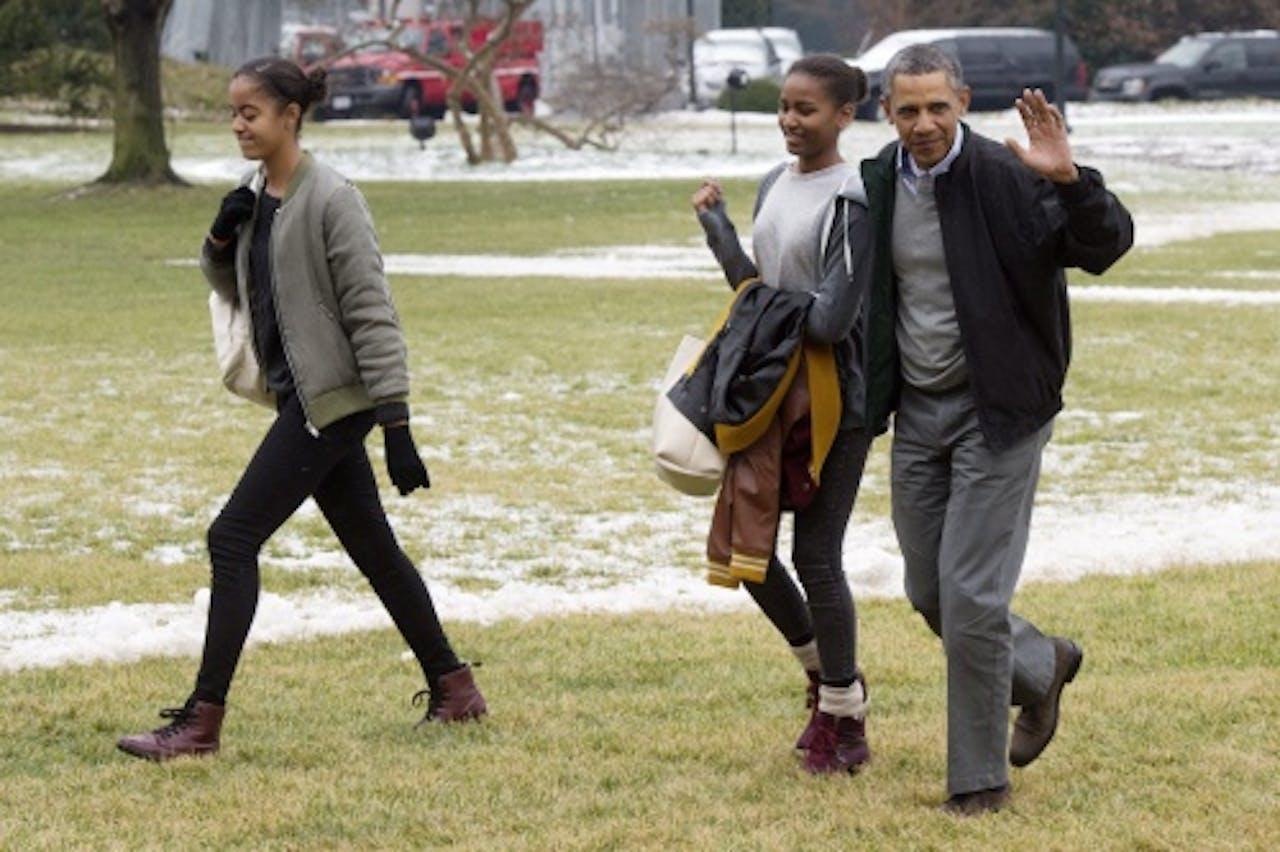 Malia, Sasha en president Obama - EPA