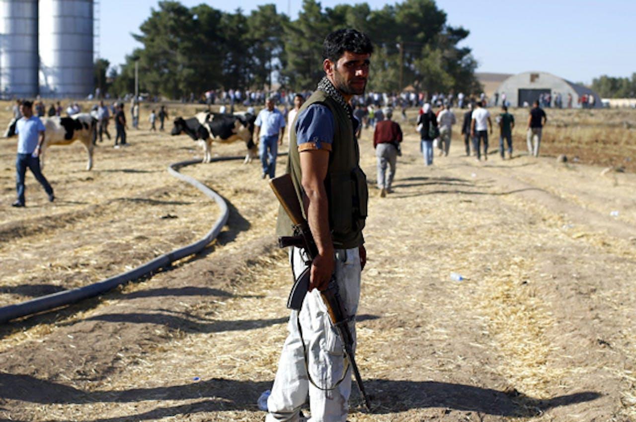 Koerdische strijder bij de stad Kobani