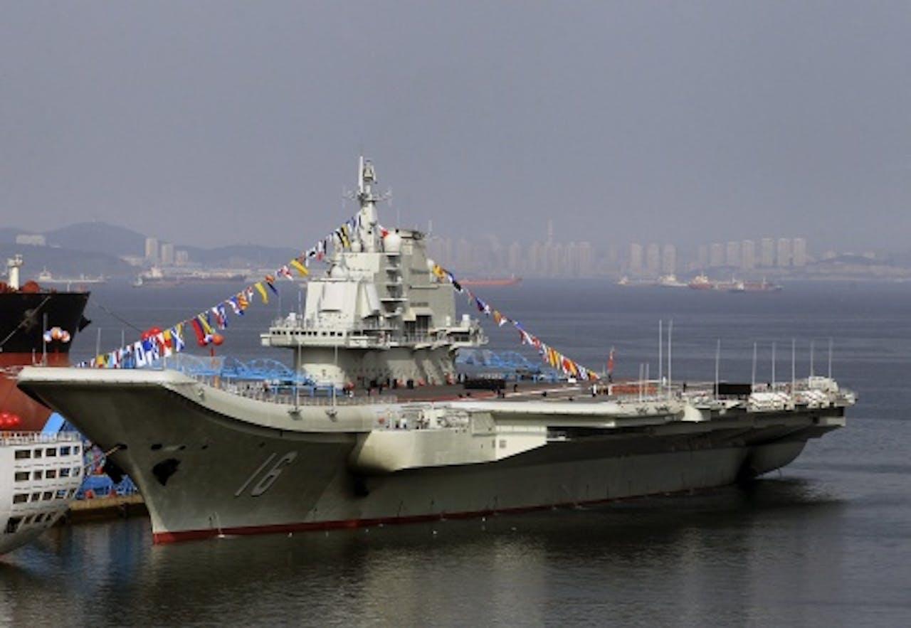 Het bestaande Chinese vliegdekschip, de Liaoning. EPA