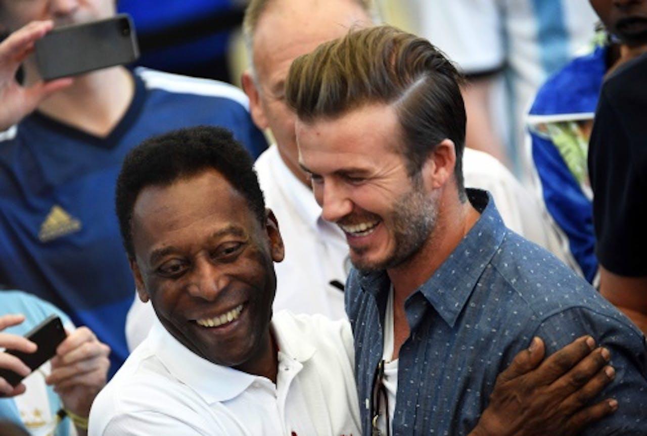 EPA Pele (l) met David Beckham (r).