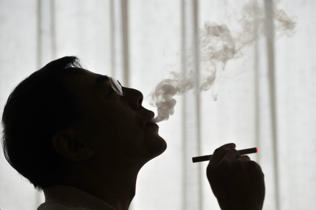 Foto: ANP - Hon Lik, de uitvinder van de elektronische sigaret