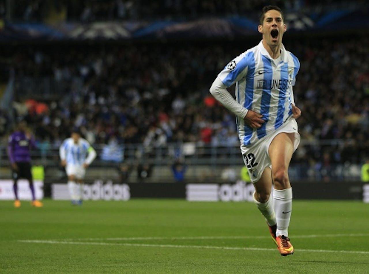 Isco van Malaga viert de openingstreffer tegen FC Porto. EPA