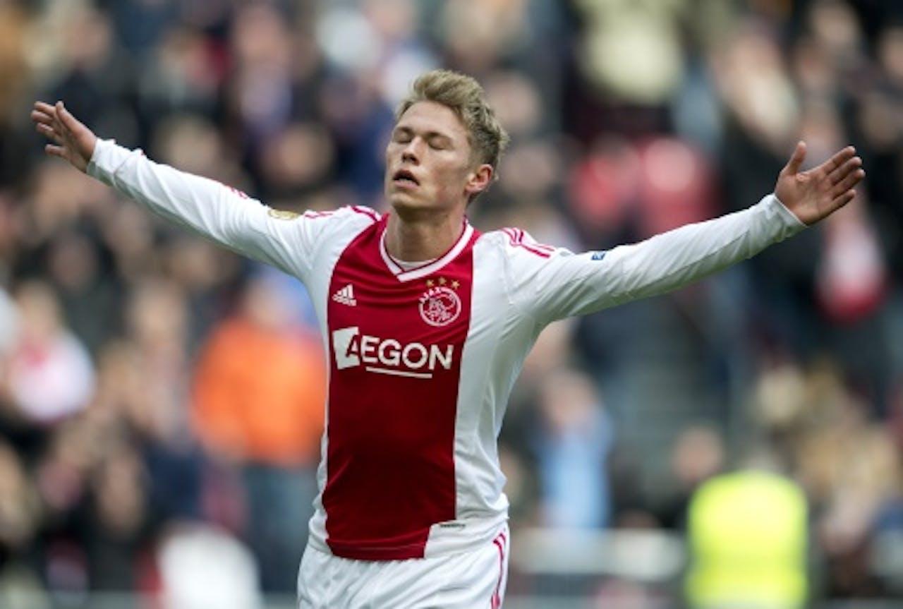 Viktor Fischer van Ajax viert zijn openingstreffer. ANP