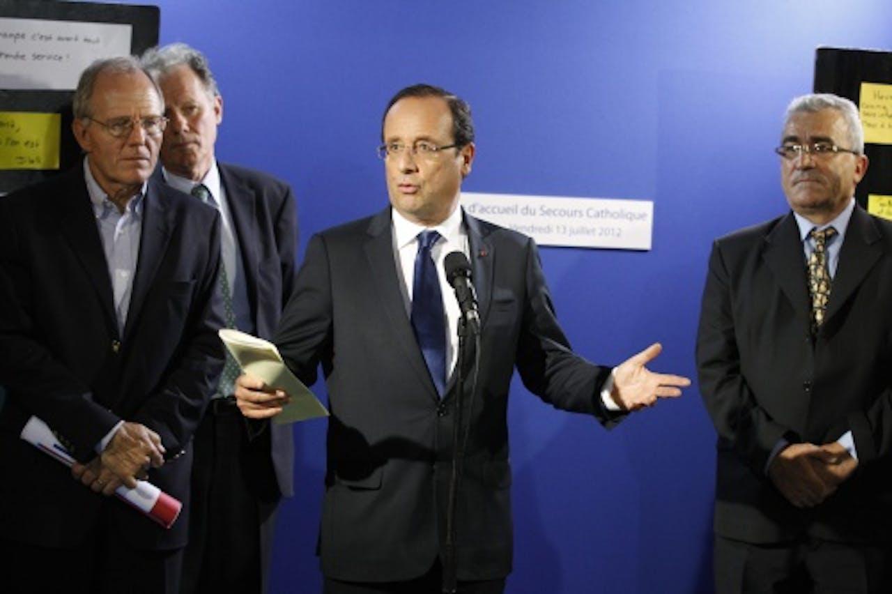 President Hollande op bezoek bij Secours catholique. EPA