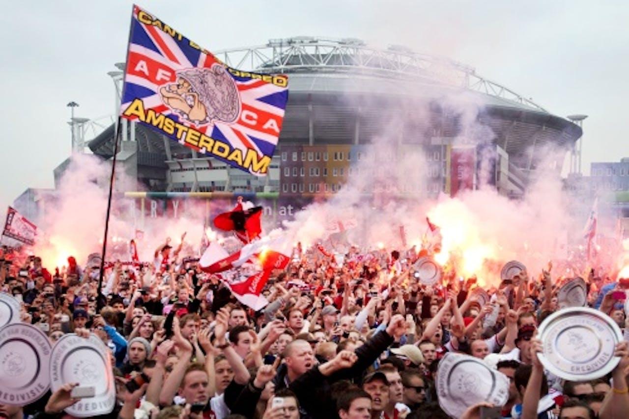 Supporters bij de huldiging van Ajax vorig jaar. ANP