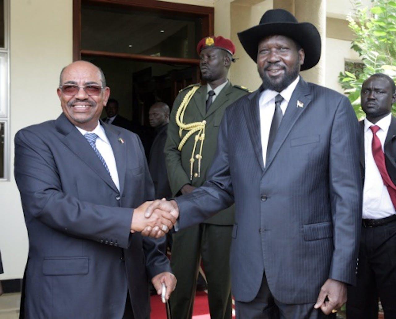 Omar Hassan al-Bashir (L), EPA