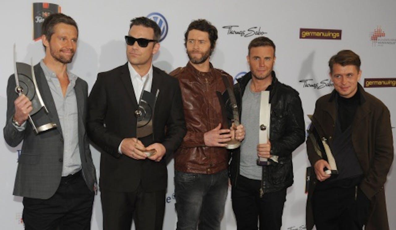 Gary (2e van rechts) met de overige bandleden van Take That. EPA