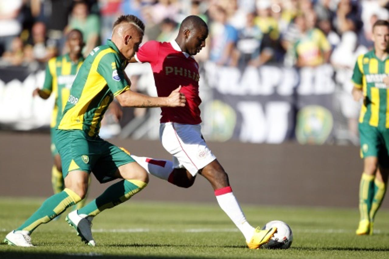 Jetro Willems (R) van PSV scoort de 3-0 tijdens de wedstrijd tegen ADO, ANP