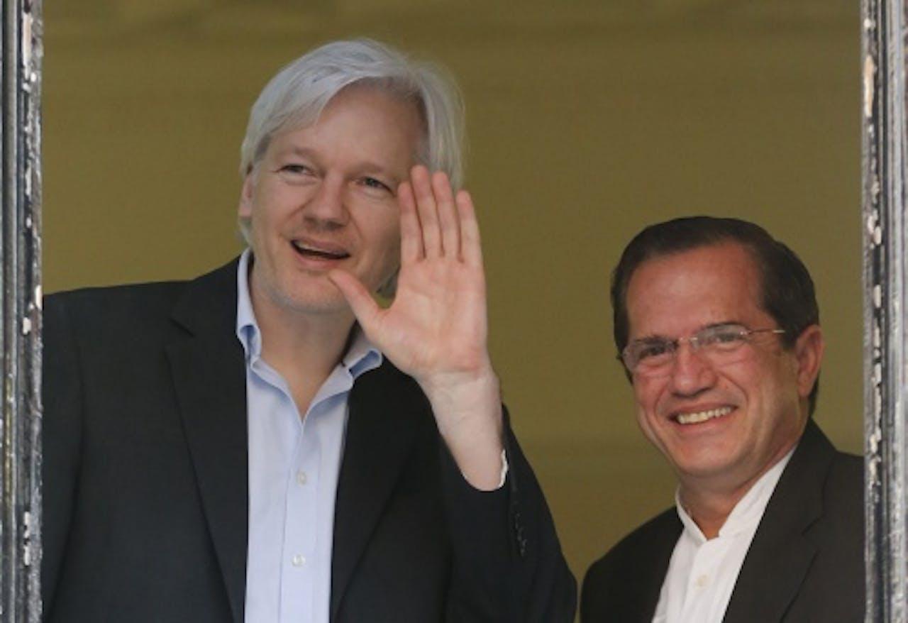 Julian Assange (L). EPA